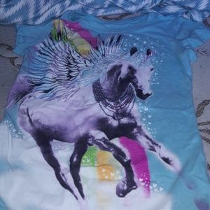 Shirt w/ Unicorn on front of the Shirt.